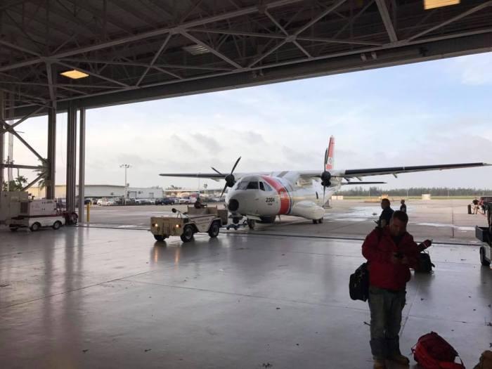 MIST team prepares to depart Mobile, AL, on the U.S. Coast Guard HC-144.