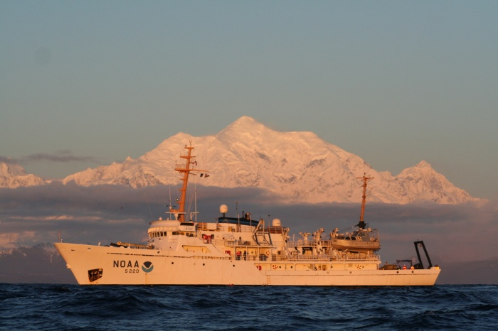 NOAA Ship Fairweather in the Gulf of Alaska, with Mount Fairweather in the background.